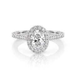 GIA certified oval 1.00 ct F/SI2 set in 18K W/G micropave set halo ring. TCW 2.25+ cts