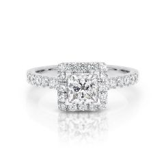 GIA certified princess 0.70 ct F/SI2 set in 18K W/G halo ring. TCW 1.20+ cts