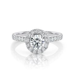 GIA certified round 0.70 ct F/SI2 set in 18K W/G halo ring. TCW 1.20+ cts