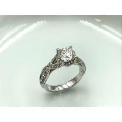 Stunning twist diamond band ring with 1.01 ct centre diamond